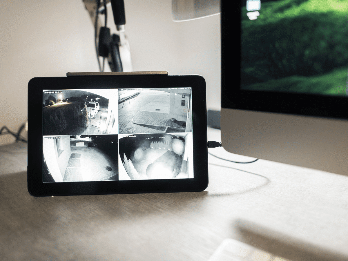Tablet displaying four different security camera screens.